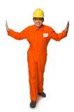 L'homme dans des combinaisons oranges d'isolement sur le blanc Photos stock