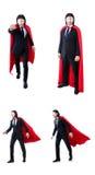 L'homme dans la couverture rouge d'isolement sur le blanc Photos stock