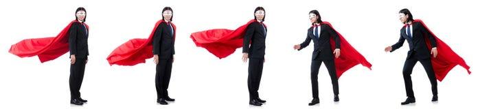 L'homme dans la couverture rouge d'isolement sur le blanc Photo libre de droits