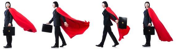 L'homme dans la couverture rouge sur le blanc Photographie stock libre de droits