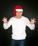 L'homme dans le visage de la Santa de cloche affiche terrible Photographie stock libre de droits