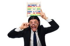 L'homme drôle avec la calculatrice et l'abaque Photographie stock