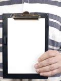 L'homme est tablette de fixation pour l'écriture Image stock