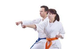 L'homme et la femme battent le bras de poinçon Image stock