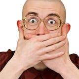 L'homme excited émotif maintiennent sa bouche fermée images libres de droits