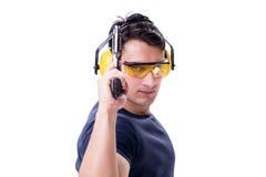 L'homme faisant le tir de sport de l'arme à feu d'isolement sur le blanc Photographie stock