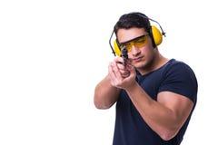 L'homme faisant le tir de sport de l'arme à feu d'isolement sur le blanc Photos stock
