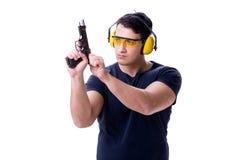 L'homme faisant le tir de sport de l'arme à feu d'isolement sur le blanc Photographie stock libre de droits