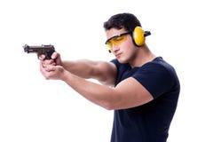 L'homme faisant le tir de sport de l'arme à feu d'isolement sur le blanc Image libre de droits
