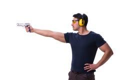 L'homme faisant le tir de sport de l'arme à feu d'isolement sur le blanc Images stock