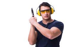 L'homme faisant le tir de sport de l'arme à feu d'isolement sur le blanc Image stock