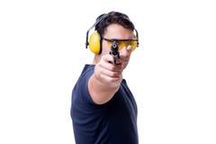 L'homme faisant le tir de sport de l'arme à feu d'isolement sur le blanc Photo libre de droits