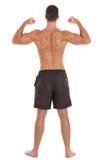 L'homme intense folâtre l'homme affichant le dos musculaire images libres de droits