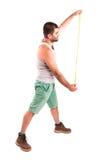 L'homme mesure le mur Photographie stock libre de droits