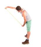 L'homme mesure le mur Image libre de droits