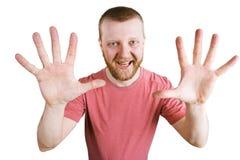 L'homme montre deux mains avec des doigts images libres de droits