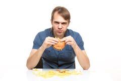 L'homme n'est pas hamburger insipide de consommation soigneuse Images libres de droits
