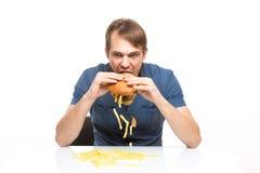 L'homme n'est pas hamburger insipide de consommation soigneuse Images stock