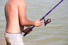 L'homme pêche pour l'amorce Photo libre de droits