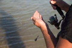 L'homme pêche pour l'amorce Image stock