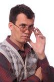 L'homme réfléchi de lunettes Image libre de droits