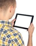 L'homme retient l'ordinateur de tablette photos libres de droits