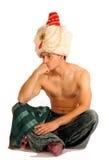 l'homme s'assied pense le turban Images stock