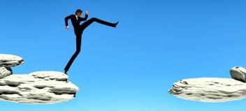 L'homme sautant ? travers l'espace des roches illustration stock