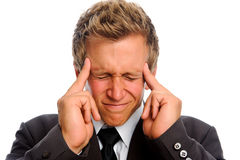 L'homme souffre du mauvais mal de tête Image libre de droits