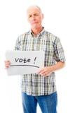 L'homme supérieur tenant une table des messages avec le texte exprime le vote Image libre de droits