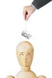 L'homme taquine une autre personne avec un paquet de dollars dans le fil Image libre de droits