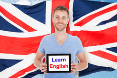 L'homme tenant la Tablette de Digital avec apprennent le texte anglais Photo stock