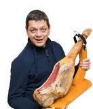 L'homme tient un jambon espagnol de Serrano Photos stock
