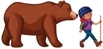 L'homme vont trimarder avec Big Bear derrière lui Images stock