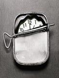 L'horloge en sardine peut Photographie stock