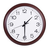 L'horloge montre la moitié de la deuxième Image stock