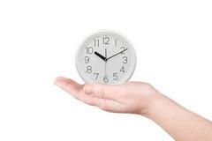 L'horloge sur une paume Images libres de droits