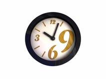 L'horloge vont à reculons, heure de retourner Photographie stock libre de droits