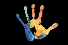 L'huile multi de couleur a peint le poing de main sur le fond noir Images libres de droits