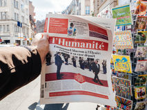 L`humanite reporting handover ceremony presidential inauguration. PARIS, FRANCE - MAY 15, 2017: Man buys L`Humanite, French newspaper reporting handover ceremony Royalty Free Stock Photos
