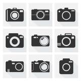 L'icona della macchina fotografica ha messo su fondo bianco con ombra lunga Immagine Stock
