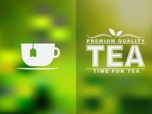 L'icona ed il testo della tazza di tè progettano con un fondo vago immagini stock libere da diritti
