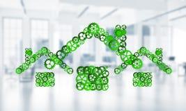L'idée d'immobiliers ou de construction a présenté par l'icône à la maison sur le fond blanc de bureau Photographie stock libre de droits