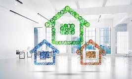 L'idée d'immobiliers ou de construction a présenté par l'icône à la maison sur le fond blanc de bureau Photo stock