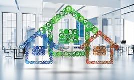 L'idée d'immobiliers ou de construction a présenté par l'icône à la maison sur le fond blanc de bureau Image libre de droits