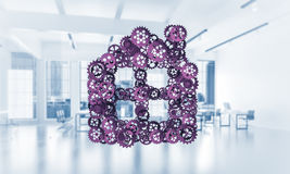 L'idée d'immobiliers ou de construction a présenté par l'icône à la maison sur le blanc Image libre de droits