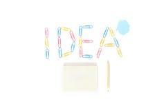 L'idea dell'autoadesivo con la matita su fondo bianco Fotografie Stock Libere da Diritti