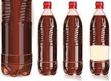 Quattro bottiglie di plastica di cola con le etichette Fotografia Stock