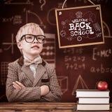 L'image composée de l'élève mignon s'est habillée comme professeur Photo stock