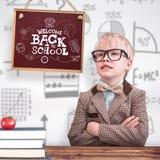 L'image composée de l'élève mignon s'est habillée comme professeur photos stock